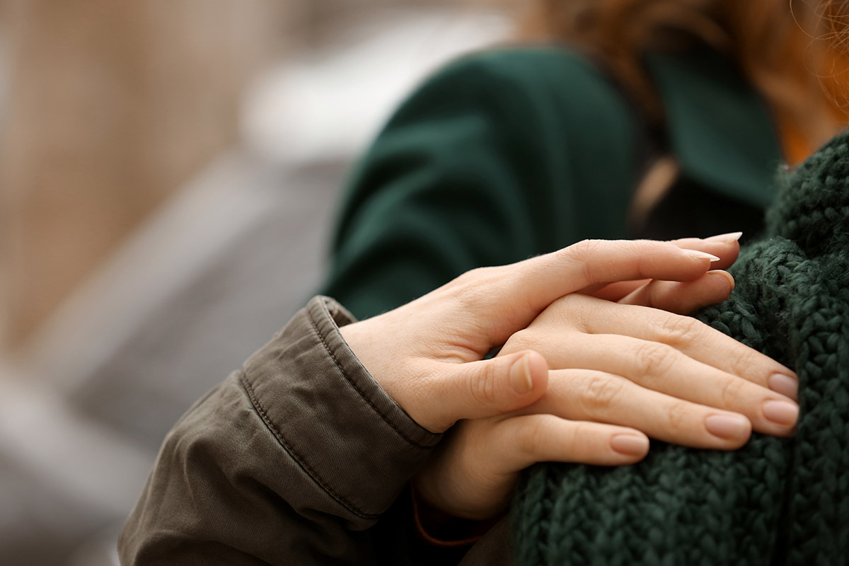 hands on a shoulder of someone seeking addiction treatment